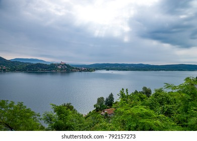 Arona, Italy, panoramic view of the Maggiore lake with the Borromea fortress of Angera in the background