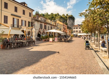 Arona, Piedmont, Italy - September 25, 2019: View of Central square with traditional bars, restaurants and shops in center of Arona, located on the shore of Lake Maggiore in Piedmont, Italy