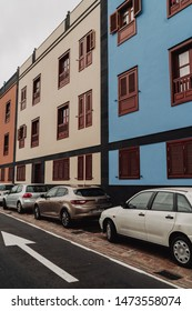 Arona, Tenerife - July 11, 2019; Colourful houses in Arona Old Town, car passed by and car parked by the buildings.  Arona is one of the main tourist destinations in the south if the Island.