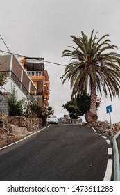 Arona, Tenerife - July 11, 2019; White car parked near the house on the high hill in Arona, Tenerife. Arona is one of the main tourist destinations in the south if the Island with stunning scenery.