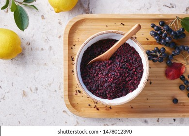 Aronia tea in a bowl. Dried aronia berries are commonly used to make antioxidant-rich herbal tea.