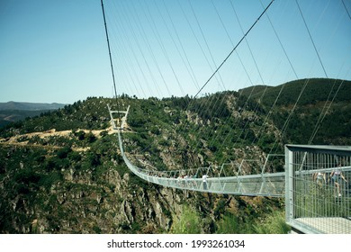 AROUCA, PORTUGAL - JUNE 15, 2021: Arouca 516 bridge, longest suspension bridge in the world now, has a length of 516m, is suspended 175m above the Paiva River. Opened on 2 May 2021 to general public.