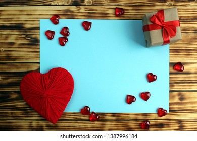 around the sheet for the inscription are hearts and a box with a gift