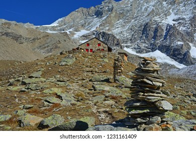 The Arpitetta mountain Refuge with cairns leading to it, in front of the mighty Weisshorn, in Switzerland. One of the highest mountains in Europe