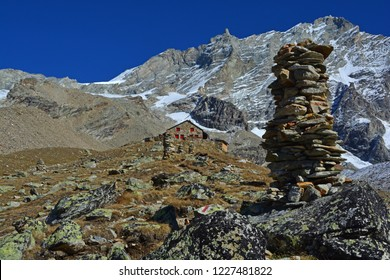 The Arpitetta Refuge with cairns leading to it, in front of the mighty Weisshorn, one of the highest mountains in Europe
