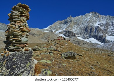 The Arpitetta Refuge with cairns leading to it, in front of the mighty Weisshorn