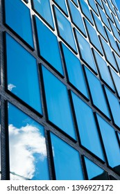 Arquitectural geometric pattern with the blue sky reflecting