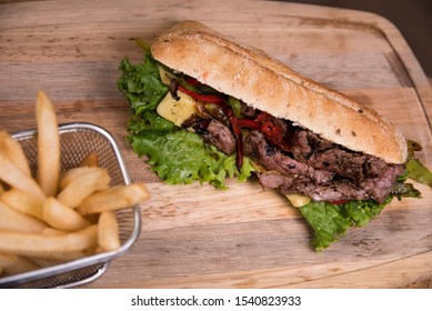 Arrachera chapata sandwich with french fries - mexican food
