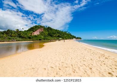 Arraial DAjuda/Porto Seguro/Bahia/Brasil - January 02, 2018: Beach of Arraial DAjuda. Coast of the beach with waves, sand and blue sky. Tourist spot