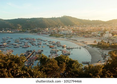 ARRAIAL DO CABO,  RIO DE JANEIRO, BRAZIL- MARCH 21, 2016:  View from a hill of the village of Arraial and its harbor at sunset.