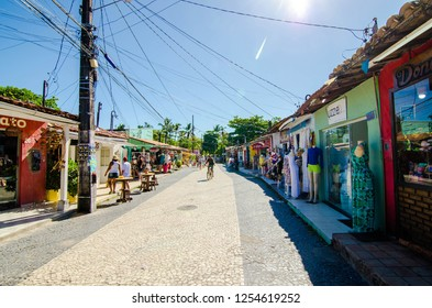 Arraial D'Ajuda/Porto Seguro/Bahia/Brasil - January 02, 2018: Facade of commercial establishments and houses in the center of Arraial D'Ajuda. Colorful shops and homes. Tourist spot. Street view.