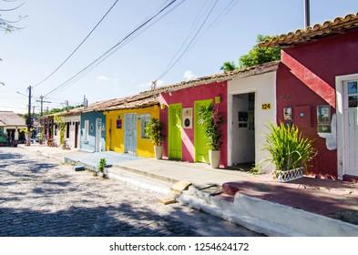 Arraial D'Ajuda/Porto Seguro/Bahia/Brasil - January 02, 2018: Facade of commercial establishments and houses in the center of Arraial D'Ajuda. Colorful shops and homes. Tourist spot. Street view.