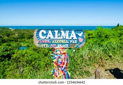 Arraial D'Ajuda/Porto Seguro/Bahia/Brasil - January 02, 2018: Motivational message board in the center of Arraial D'Ajuda. Ocean seen in the background. Tourist spot.