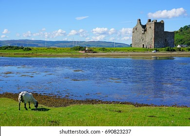 ARRAN, SCOTLAND -12 JUL 2017- View of the Lochranza Castle on the Isle of Arran on the Firth of Clyde. The population in Lochranza is less than 200 people.