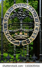 ARRAN, SCOTLAND -12 JULY 2017-  View of a metal gate with the English motto Honi Soit qui Mal Y Pense on a garden gate s of the historic landmark Brodick Castle of the Isle of Arran in Scotland.
