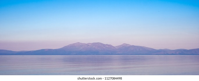 Arran taken from Seamill in Ayrshire on a very hot early morning. The image is soft and atmospheric due to the warm hazy weather in Scotland