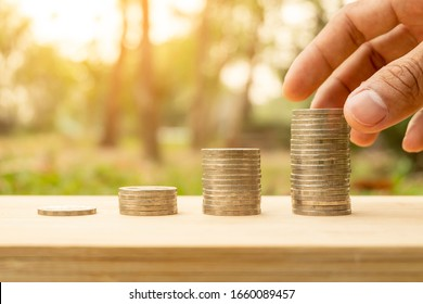 Arrange coins into heaps with hands, content about money