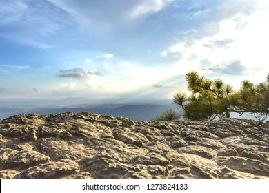 Arrange of mountain view from mountain top and rugged cliffs on foreground at Phu Kra Dueng National Park, Loei Thailand.
