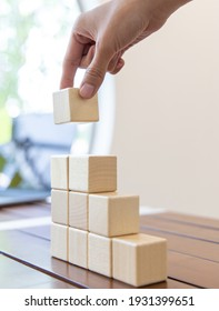Arrange the wooden blocks into steps, higher the marketing strategy the more effort is required, Ladder of success, Driving business at the peak concept.