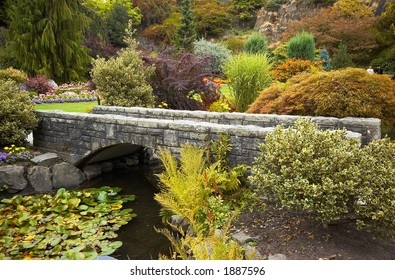 Arranged flowers along a bridge in Vancouver Queen Elizabeth Park. More with keyword group14h