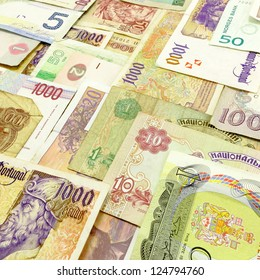 Arranged foreign currency and money with denomination of each note visible.