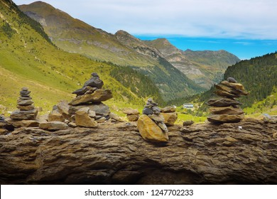 Arranged small stony piles on the rock with mountains on background