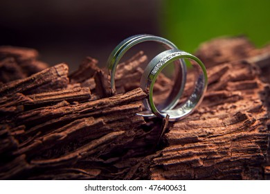 Arranged wedding rings placed on wood