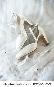 arranged white bridal shoes, wedding ceremony