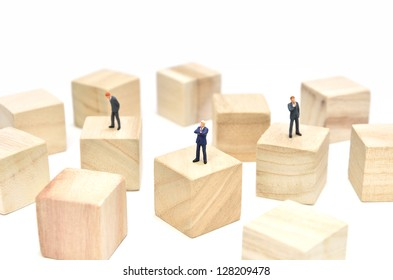 Arranged Wood cube and Businessman on white background.