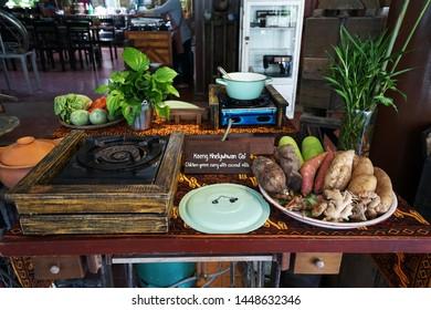 Arrangement of Buffet self service station of 'Keang Kheiywhwan Gai' chicken green curry in coconut milk,Thai southern cuisine