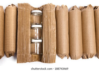 An arrangement of cardboard wrapped products ready to be shipped against a white background.