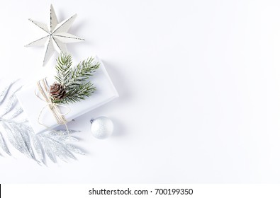 an arrangement of christmas decorations and a gift box flatlay symbolic image christmas