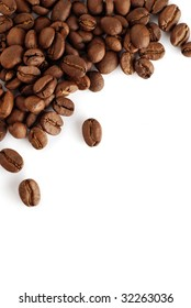an arrangement of coffee beans on a white background