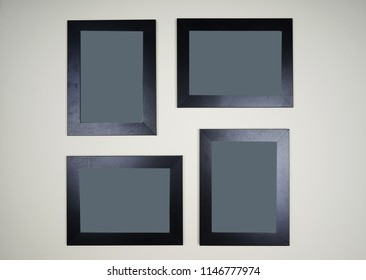 Arrangement of empty picture frame