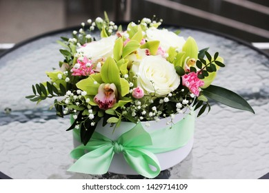 arrangement of flowers in a box