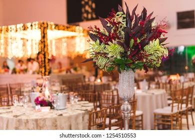 Arrangement of flowers in event decoration.