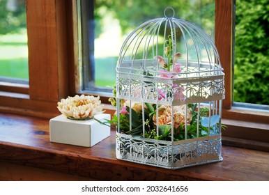 An arrangement with flowers in vintage birdcage.