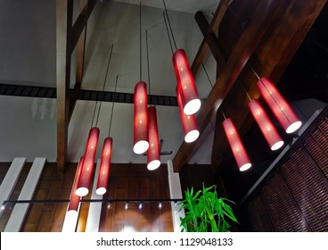 Arrangement of hanging lighting fixtures in Thai style