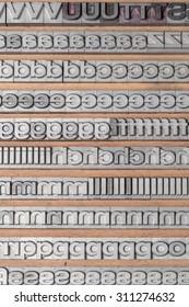 Arrangement of letterpress lead letters in row