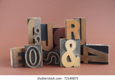 arrangement of letterpress wood type on a brown background