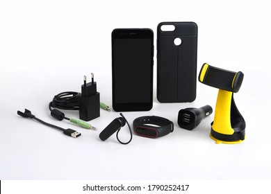 Arrangement of mobile accessories used in the car, including charger, handsfree, holder and stereo cable