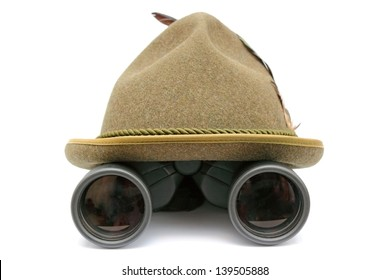 arrangement with oktoberfest hunting hat and binoculars over white background