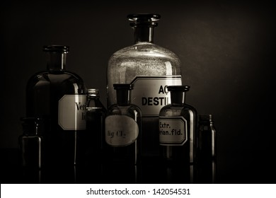 Arrangement of old pharmacy bottles, sepia toned