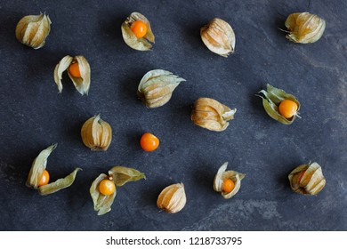 Arrangement of physalis fruit, Cape Gooseberries, on natural slate background