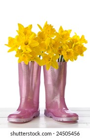 Arrangement of spring daffodils in pink wellington boots