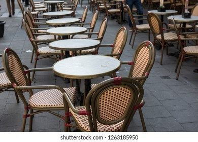 Arrangement of tables and chairs outside a restaurant at Galeries Royales Saint Hubert. The sitting arrangement is for people to dine at the restautant. It seems to be empty at the moment.