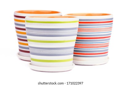 Arrangement of Three Empty Striped Flower Pots isolated on white background