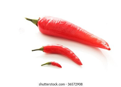 Arrangement of three red chili of different sizes