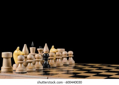 The arrangement of white figures on a chessboard, with a black pawn on a black background