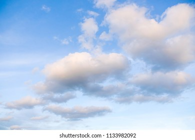 The arrangement of the white fluffy clouds in the morning.